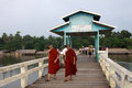 Two monks walking on U-Bein Bridge in Amarapura Royalty Free Stock Images