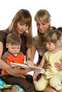 Two mothers read books to their children Royalty Free Stock Photo