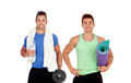 Two muscular men with gym equipment isolated on a white background Royalty Free Stock Photography
