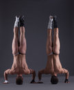 Two muscular wrestlers stand on head Royalty Free Stock Photos