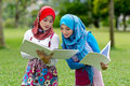 Two Muslim girls with books  Stock Photography