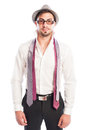 Two neckties hanging on male model wearing glasses and hat Royalty Free Stock Photo