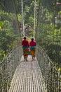 Two nepali women in chitwan nepal cross a bridge Royalty Free Stock Image