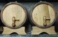Two oak wooden barrels on racks. Royalty Free Stock Photo