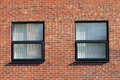 Two office windows modern red brick office building Stock Image
