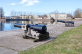 Two old cannons on the shore of the Italian pond in the May afternoon. Kronstadt, Russia Royalty Free Stock Photo