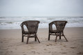 Two old chairs in a beach Royalty Free Stock Photo