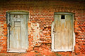 Two old doors and brick wall Royalty Free Stock Images