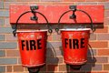 Two old fire buckets victorian on the railway station wall brownhills west railway station staffordshire england uk western europe Royalty Free Stock Photo