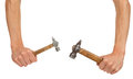 Two old hammers in hands Royalty Free Stock Photo