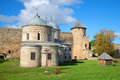 Two old medieval Church and tower, sunny day. Ivangorod fortress, Russia Royalty Free Stock Photo