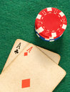 Two old poker card aces and poker chips. Stock Image