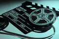 Two old reels of film and cinema clap Royalty Free Stock Photo
