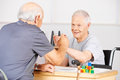 Two old senior men holding hands for congratulation in a nursing home Stock Images