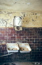 Two old sink rusty in a dilapidated room Stock Image