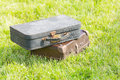 Two old suitcase on grass Royalty Free Stock Photo