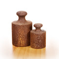 Two old weights closeup of rusty with five and kilograms on wooden floor Royalty Free Stock Photos