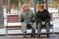 Two older man sitting on the bench in the park and talking in Volgograd Royalty Free Stock Photo