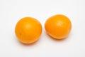 Two orange fruit  on white backgrounds Royalty Free Stock Photo