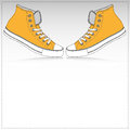 Two orange sneakers paper background Royalty Free Stock Photo