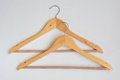 Two over lapping wooden coat hangers isolated Stock Photo