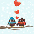 Two owls on tree branches with hearts