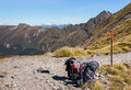 Two packed backpacks on hiking track in New Zealand Royalty Free Stock Photo