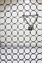 Two padlocks suspended by one chain Royalty Free Stock Photo