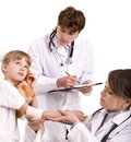 Two paediatrician treat happy child. Medicine. Royalty Free Stock Photo