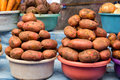 Two pails of potatoes on market counter Royalty Free Stock Photos