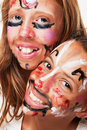 Two painted faces Stock Images