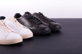Two pair of sneakers shoes on black background. Black and white shoe. Royalty Free Stock Photo