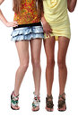 Two pairs female sexy legs on a floor Royalty Free Stock Photo
