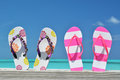 Two pairs of flip flops against atlantic exuma bahamas Stock Photo