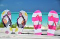 Two pairs of flip flops against atlantic exuma bahamas Stock Photos