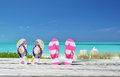 Two pairs of flip flops against ocean exuma bahamas Stock Photography