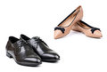Two pairs of men and women shoes over white Royalty Free Stock Photo
