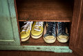 Two pairs of sneakers in the cabinet. Royalty Free Stock Photo