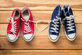 Two pairs of sneakers for men and women - the concept of love. Royalty Free Stock Photo