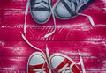 Two pairs of sneakers on a pink background Royalty Free Stock Photo