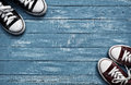 Two pairs of sneakers on vintage blue background Royalty Free Stock Photo