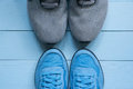 Two pairs of sport sneakers toe to toe Royalty Free Stock Photo