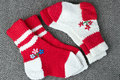 Two pairs of  wool red and white   knitted socks Royalty Free Stock Image