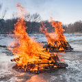 Two pallet fires burn brightly in empty lot Royalty Free Stock Image