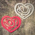 Two paper heart ornamental shape on wood background Stock Photos