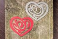 Two paper heart ornamental shape on wood background Royalty Free Stock Photos