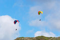 Two para gliders on a cloudy day flying Royalty Free Stock Photo