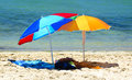 Two parasols colorful on sandy beach Royalty Free Stock Photo