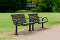 Two park benches wooden in Royalty Free Stock Photos
