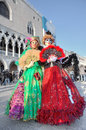 Two participants in venetian carnival.
